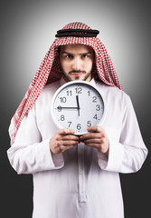 Arabian man with the clock