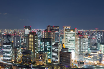 Osaka city business downtown view from Umeda sky building at night, Japan