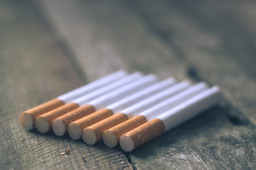 Cigarettes on a wooden board