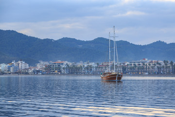 Vintage ship with marmaris city background.