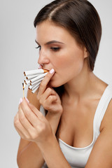 Smoking Cigarette. Woman Lighting Cigarettes With Match