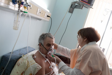 Nurse setting oxygen mask