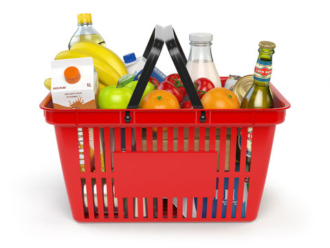 Shopping market basket with variety of grocery products isolated on whi