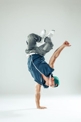 Man break dancer on white studio background