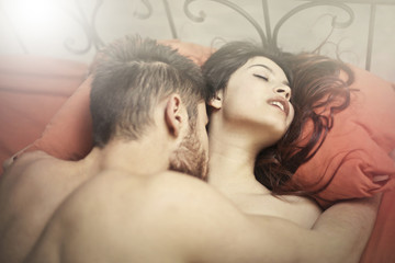 Couple making love in red bed