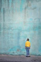 Man looking at the blue wall