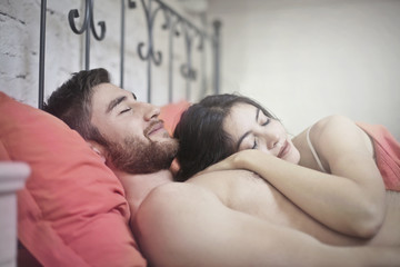 Couple sleeping with smile on their face