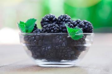 Blackberries on wooden deck in bowl