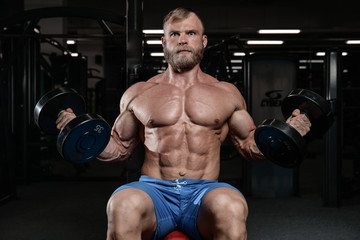 brutal muscular man with beard unshaven fitness model healthcare Wall mural