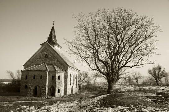 Abandoned church of St. Linhart on frozen Musov reservoir