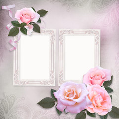 Pink roses and frame on a gentle romantic vintage background