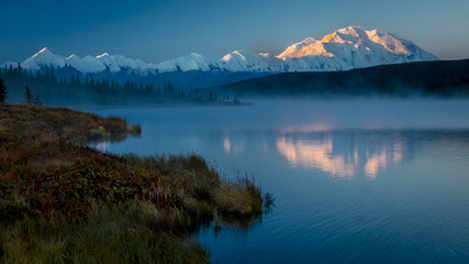 AUGUST 28, 2016 - Mount Denali at Wonder Lake, previously known as Mount McKinley, the highest mountain peak in North America, at 20, 310 feet above sea level. Located in the Alaska Range, Denali National Park and Preserve, Alaska - shot at Sunrise.