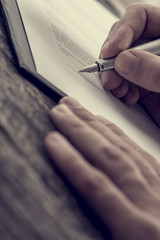 Hands putting a signature