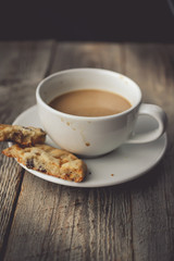 Cookies with Hot Coffee on Dirty Cup on Wood Background with Cop