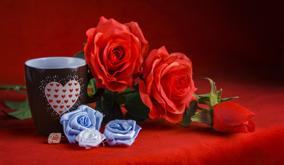 Valentine's Day: Cup of coffee or warm beverage and red roses on dark red background