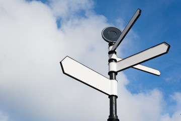 Blank Directional Signpost Arrows Over Blue Sky