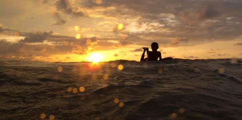 kid on the surfboard sunset silhouette