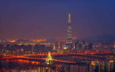 Korea,Seoul city skyline and Lotte World mall at nigth.