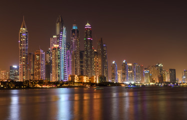 Panoramic night view of Dubai Marina skyscrapers