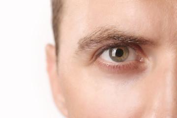 Close up view of a green man's eye looking at camera