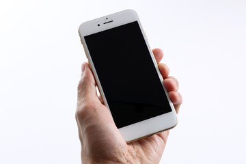 Male hand holding white smartphone