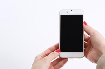 Female hands using white smartphone