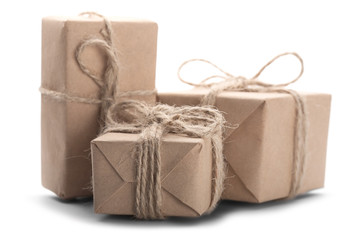 Boxes with gift wrapped in kraft paper on isolated white backgro
