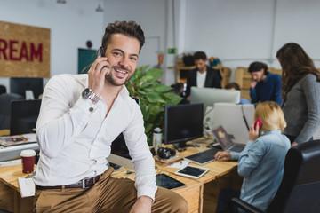 An office employee talking phone