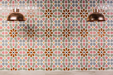 Copper Lamps and moroccan wall tiles.