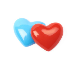 Two glossy heart shaped beads isolated