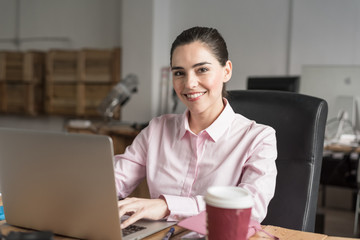 Business woman sitting with a computer