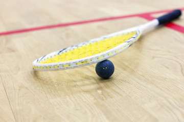 Closeup of squash racket and ball