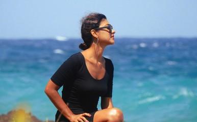 Beautiful Young Woman At Ocean