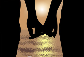 Silhouette of two lovers at sunset and the sea.