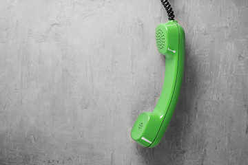 handset from landline phone on the background wall