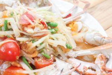 Spicy papaya salad with blue crab sea food.