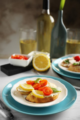 Plate with delicious bruschetta on table