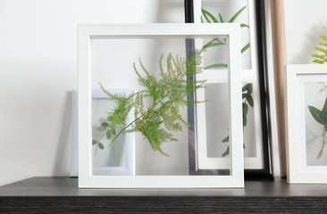 Frames with green leaves