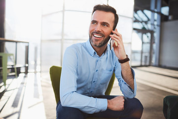 Young bearded man using a mobile phone