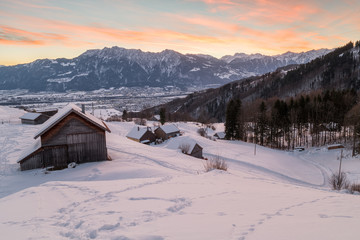 Swiss Winter - Hut and mountain covered in snow