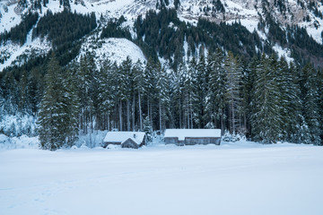 Swiss Winter - Barn under mountain