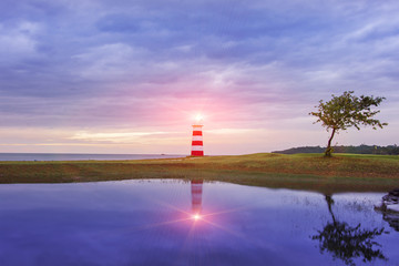 lighthouse seascape sunset and twilight evening time Wall mural