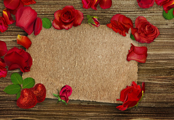 Red roses, petals, and red hearts on wooden background. Place for text. Valentine's card
