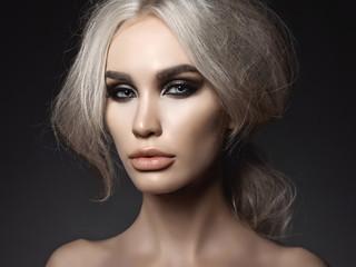 Beautiful blonde woman with smoky eyes makeup