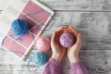 clew of wool in woman hands