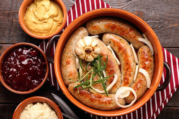 Roast sausage with rosemary and garlic