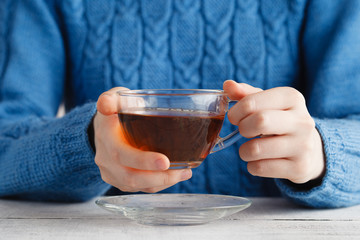 Woman hold cup of tea in hands