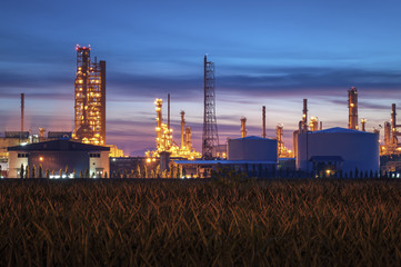 Silhouette of petrochemical plant or Oil and gas refinery at sunrise