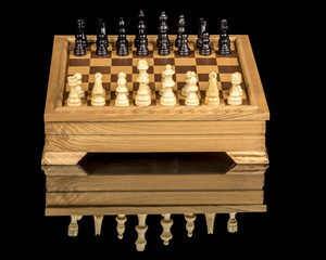 Classic wood chess set on a board