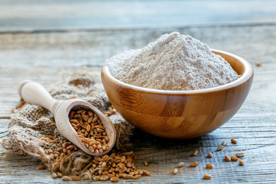 Wheat wholemeal flour in a wooden bowl.